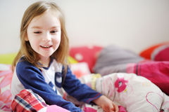 Little preschooler girl in pajamas on morning Royalty Free Stock Images