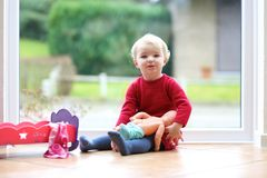 Little preschooler girl playing with doll Royalty Free Stock Photography