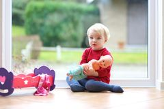 Little preschooler girl playing with doll Royalty Free Stock Photo