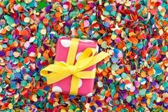 Little present on confetti Stock Photo
