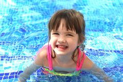 Little pretty beautiful girl swimming in the pool child. Kid baby infant youngster aquatics water sport active game joy merriment mirth gaiety hilarity rejoicing Royalty Free Stock Photo