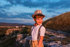 Pretty little boy in hat is smiling. royalty free stock photography