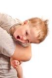 А little pretty boy yawns on hands Stock Image