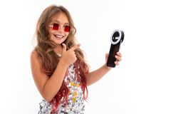 Little Pretty Caucasian Girl Do Selfie With Phone And Circle Lamp, Picture Isolated On White Background Stock Image