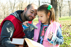 Little pretty child and father reading the book Royalty Free Stock Images
