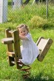 A little pretty child swinging stock photos