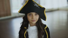 Little girl in costume of pirate posing at camera. Little pretty girl in costume of pirate posing at camera. Full HD stock footage