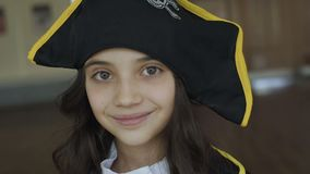Little girl in costume of pirate posing at camera. Little pretty girl in costume of pirate posing at camera. Full HD stock video footage