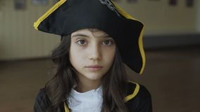 Little girl in costume of pirate posing at camera. Little pretty girl in costume of pirate posing at camera 4K stock video