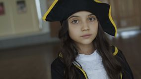 Little girl in costume of pirate posing at camera. Little pretty girl in costume of pirate posing at camera 4K stock video footage