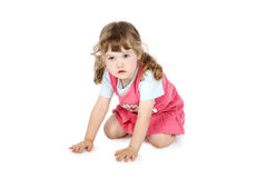 Little pretty girl crawls on floor Royalty Free Stock Images