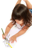 Little pretty girl drawing and coloring Stock Photography
