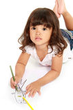 Little pretty girl draws and coloring Royalty Free Stock Photo
