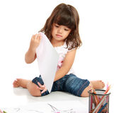 Little pretty girl draws and coloring Royalty Free Stock Images