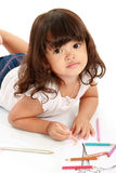 Little pretty girl draws and coloring Royalty Free Stock Photos