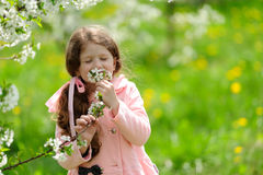 Little pretty girl dreaming in the green garden Royalty Free Stock Photography
