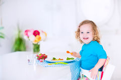 Little pretty girl eating salad for lunch Royalty Free Stock Images