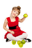Little pretty girl with green apples Royalty Free Stock Photos