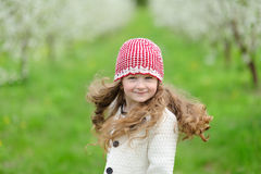 Little pretty girl in the green garden Royalty Free Stock Photos