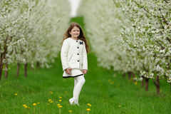 Little pretty girl in the green garden Stock Images