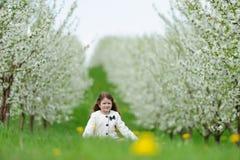 Little pretty girl in the green garden Stock Photos