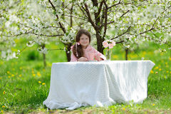 Little pretty girl in the green garden Stock Photography