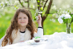 Little pretty girl in the green garden Royalty Free Stock Image