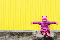 Little pretty girl in gumboots Stock Images