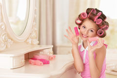 Little pretty girl   in hair curlers Royalty Free Stock Photos