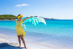 Little pretty girl have fun with beach towel and Stock Photos