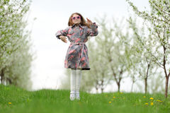 Little pretty girl jumping in the green garden Stock Images