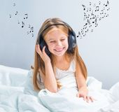 Little pretty  girl listening to music Royalty Free Stock Photography
