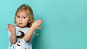Portrait of adorable surprised little girl isolated on a green royalty free stock photos