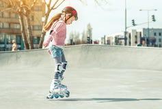 Little Pretty Girl On Roller Skates Stock Image