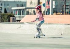 Little Pretty Girl On Roller Skates Stock Photos