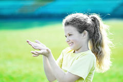 Little pretty girl overflowing with happy emotions doing sport activities at summer. Little girl overflowing with happy emotions doing sport activities at summer Royalty Free Stock Image