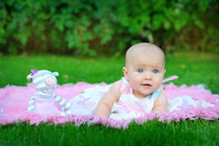 Little pretty girl playing on the lawn Royalty Free Stock Images