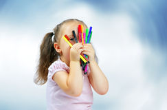 Little pretty girl playing with markers Royalty Free Stock Photos