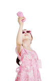 Little pretty girl is playing with toy mobile Royalty Free Stock Image