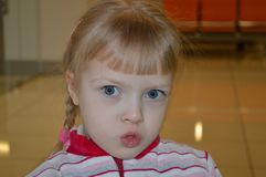 A little pretty girl pouts. all emotions are on her face. stock photos