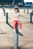 Little pretty girl riding Royalty Free Stock Image
