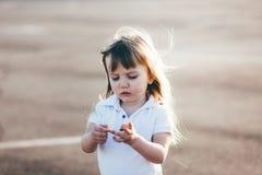Little pretty girl riding Stock Photo