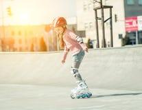 Little pretty girl on roller skates Stock Images