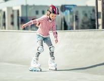 Little pretty girl on roller skates Royalty Free Stock Photo