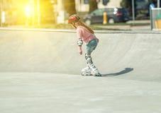 Little pretty girl on roller skates Stock Photography