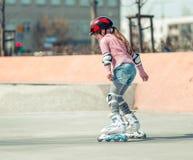 Little pretty girl on roller skates Royalty Free Stock Image