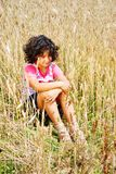 little pretty girl siting on wheat field Stock Photography