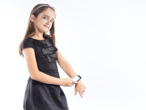 Little pretty girl with smart watch on hand. Isolation on white Stock Photo