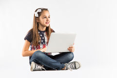 Little pretty girl studying with computer. isolated on white background Royalty Free Stock Image