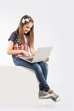 Little pretty girl studying with computer. isolated on white background Stock Photo